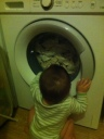 baby transfixed by the washing machine