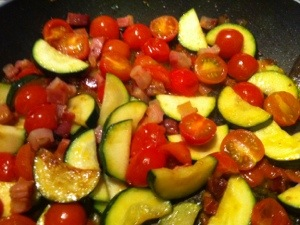 picture of bacon, courgette, tomato sauce in pan